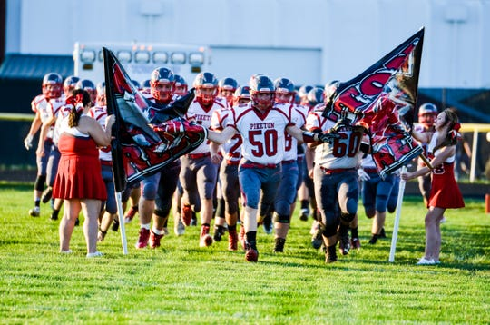 Piketon High School's football team takes the field in a game at Paint Valley High School on Sept. 14, 2018.