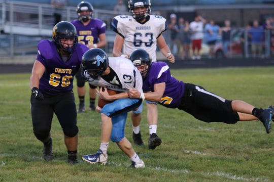 Adena running back Nate Throckmorton carries the ball against Unioto High School in a 33-15 loss to the Shermans in 2018.