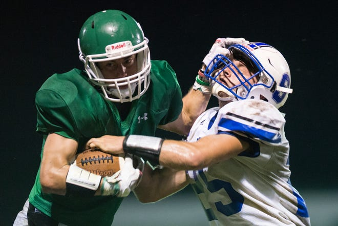 Huntington's Seth Beeler stiff arms a Southeastern defender during a game against Southeastern at Myrl Shoemaker Athletic Complex on Friday, Sept. 14, 2018.