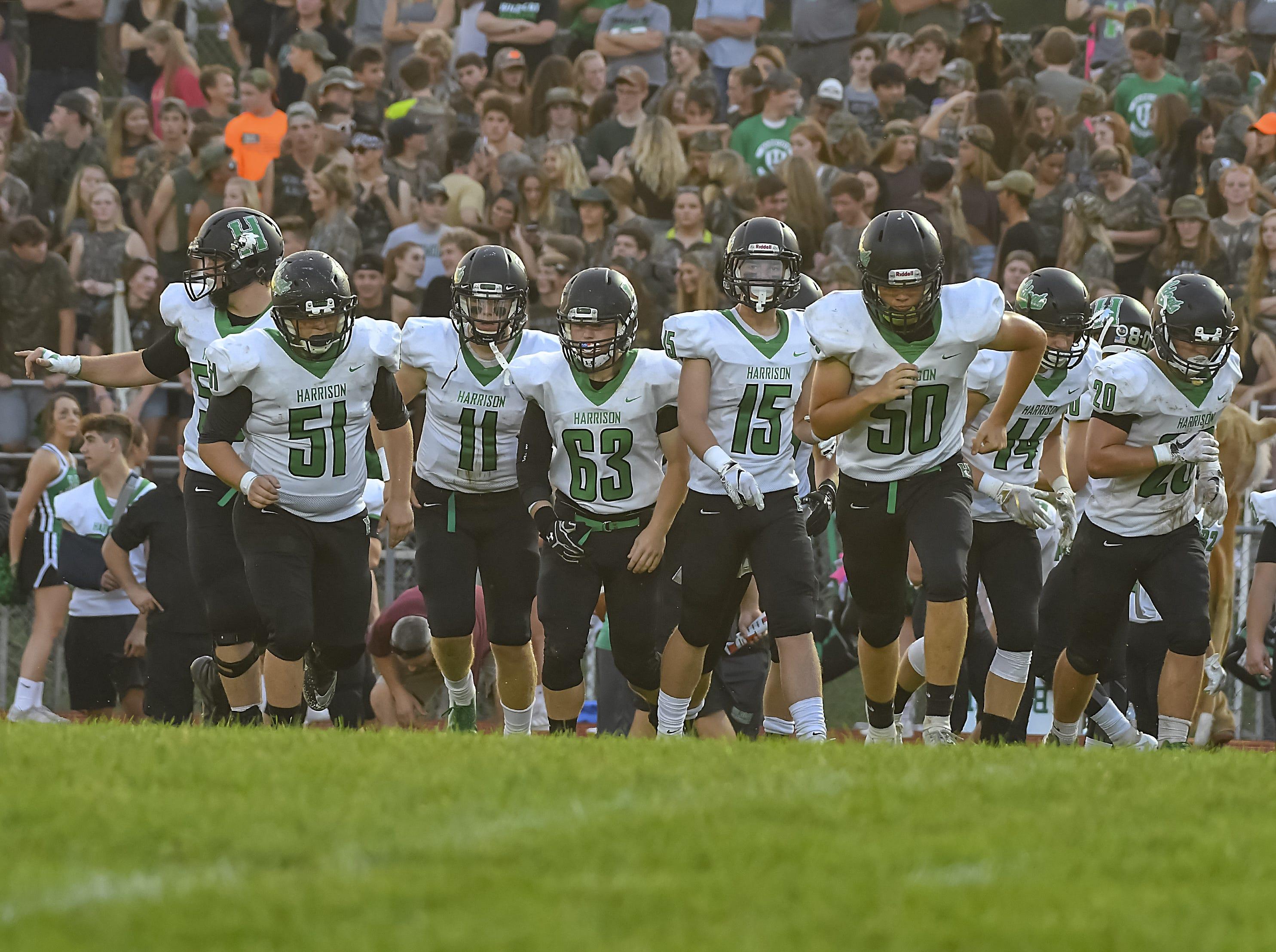 The Harrison offense runs on the field, Ross High School, Friday, September 14, 2018