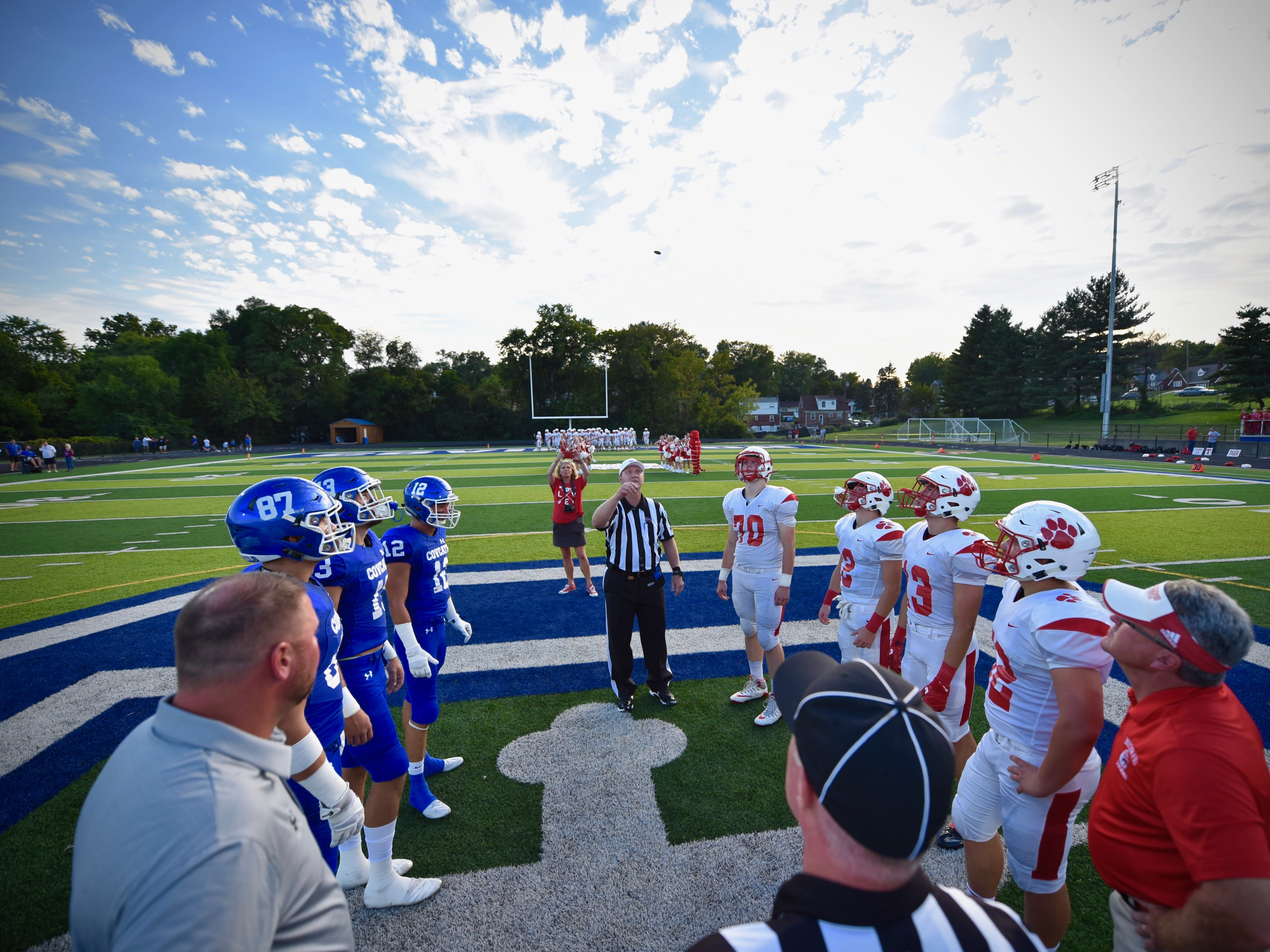 The Beechwood and Covington Catholic captains watch the coin toss prior to kickoff Friday, Sept. 14, 2018.