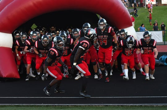 The Indian Hill Braves take the field for their game against rival Madeira, Sept. 14, 2018.