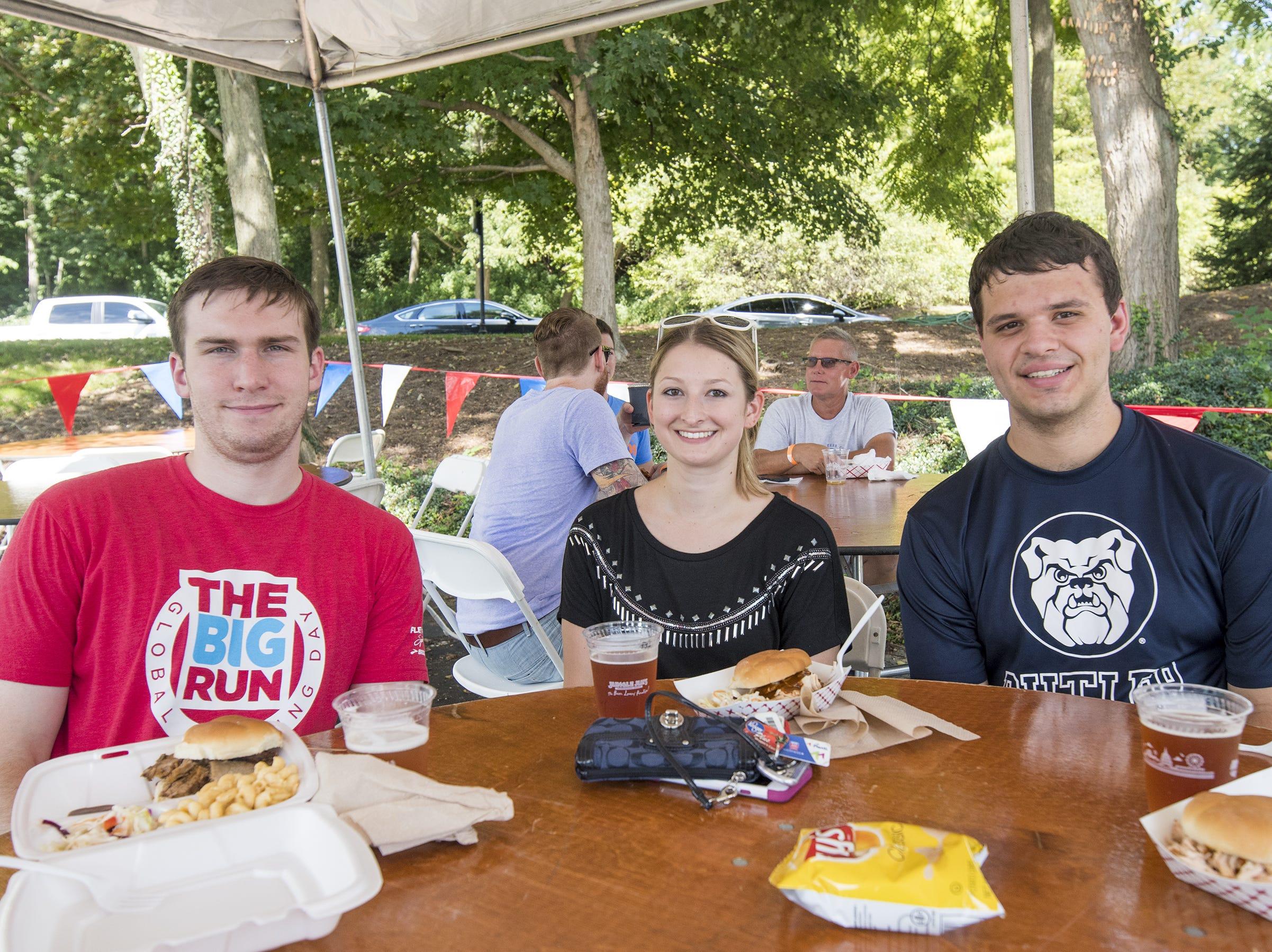 Jackson Dombrowsk, Amanda Gilarski, and Daniel Carr grab some food Fifty Fest at 50 West Brewing Saturday, September 15, 2018 in Cincinnati, Ohio.