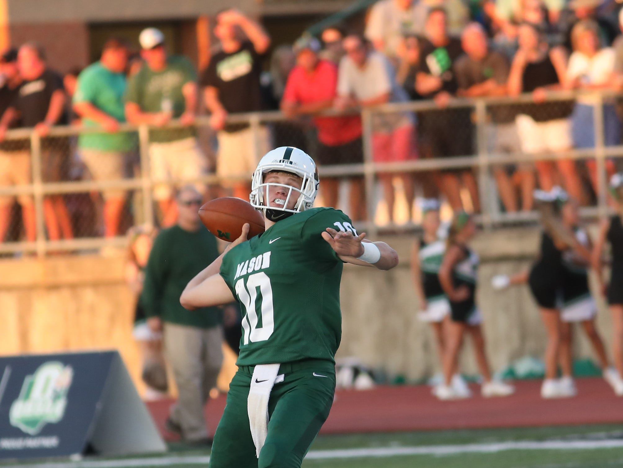 Mason's quarterback Collin Brown throws a touchdown pass for the Comets during the football game against Sycamore, Friday, Sept. 14, 2018.