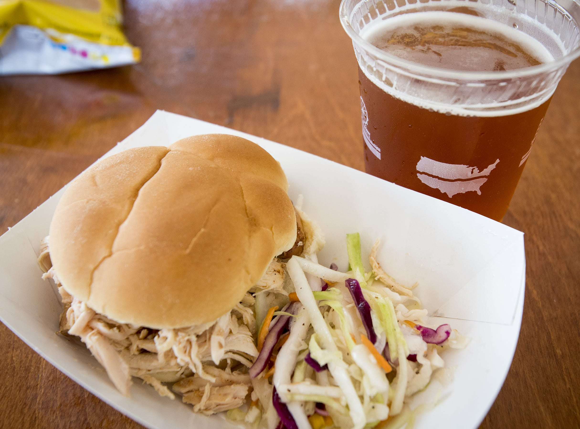 Food truck Surfside BBQ serves up pulled pork during Fifty Fest at 50 West Brewing Saturday, September 15, 2018 in Cincinnati, Ohio. The festival features beers from tons of local breweries.