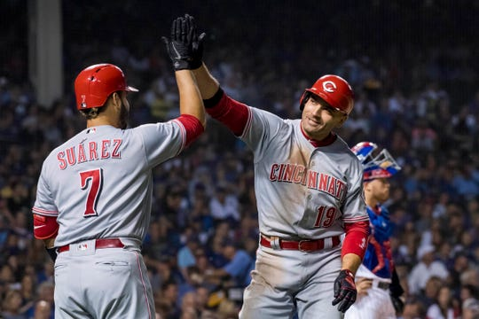Sep 14, 2018; Chicago, IL, USA; Cincinnati Reds first baseman Joey Votto (19) celebrates with third baseman Eugenio Suarez (7) after solo home run during the fourth inning against the Chicago Cubs at Wrigley Field. Mandatory Credit: Patrick Gorski-USA TODAY Sports