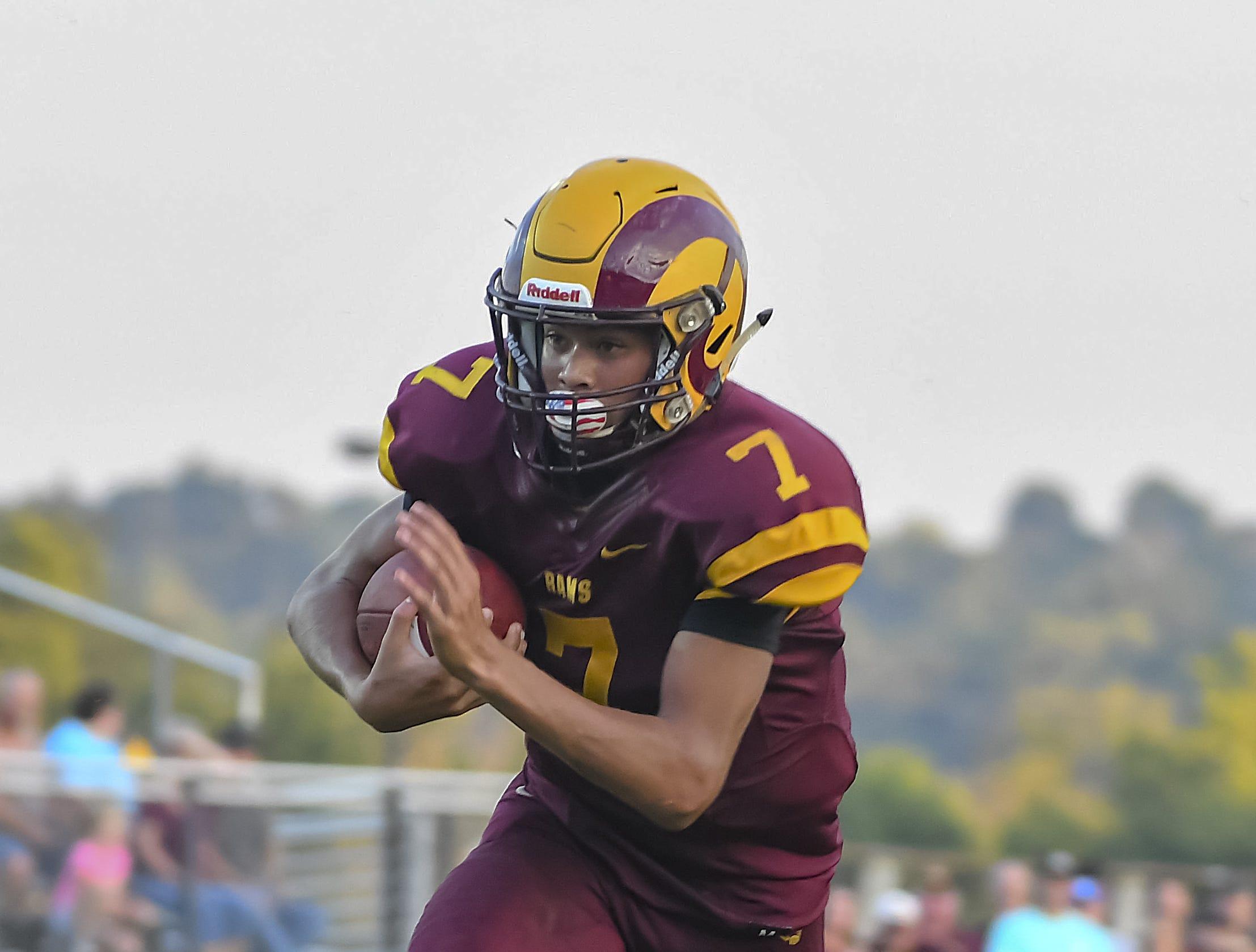 Ross quarterback C.J. Boze runs the ball against Harrison, Ross High School, Friday, September 14, 2018