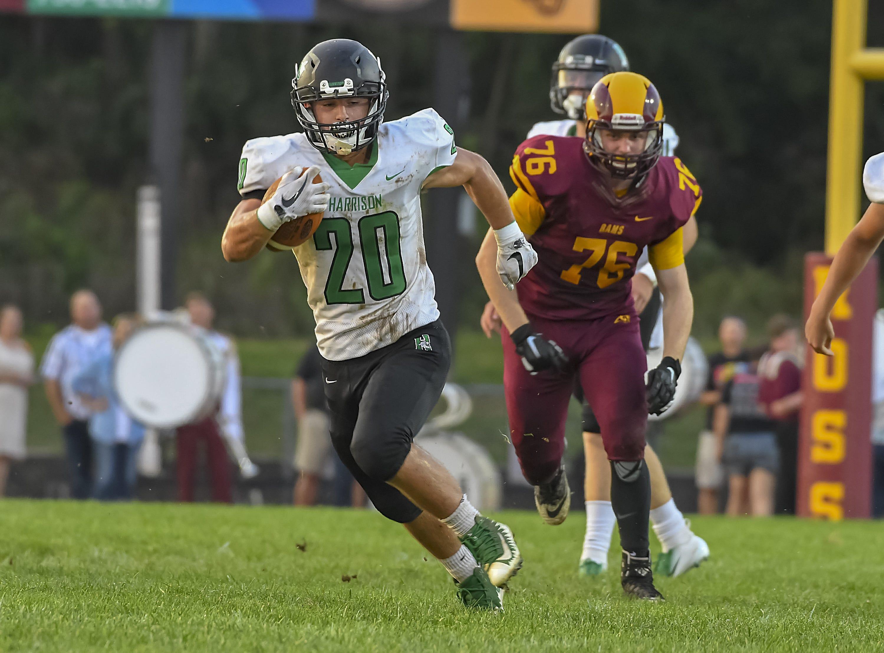 Harrison running back Jacob Reardon runs the ball against Ross, Ross High School, Friday, September 14, 2018