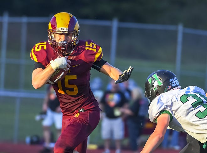 Dylan Caldwell of Ross runs the ball against Harrison, Ross High School, Friday, September 14, 2018