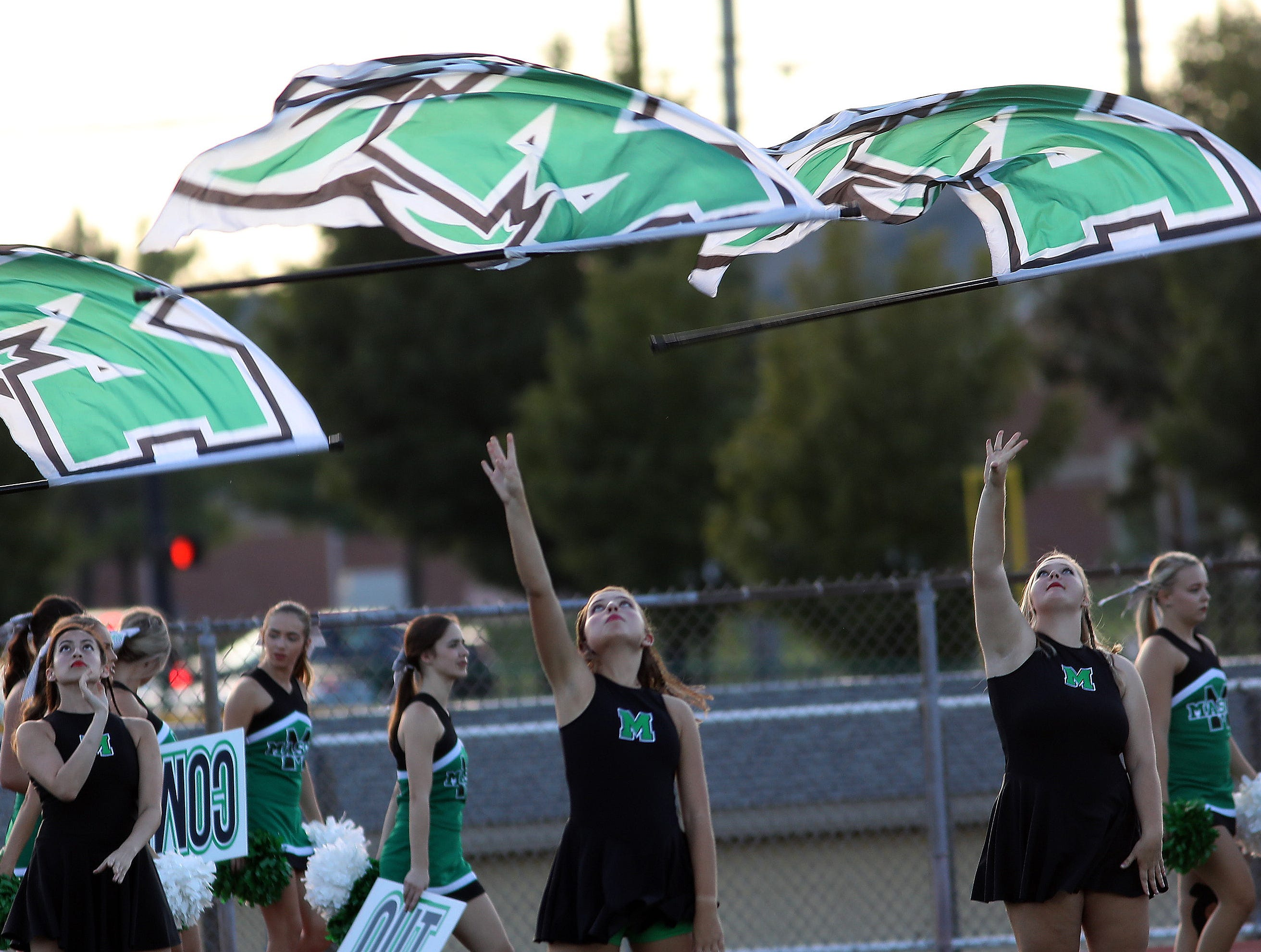Mason's cheerleaders practice before the Comets' football game against Sycamore, Friday, Sept. 14, 2018.