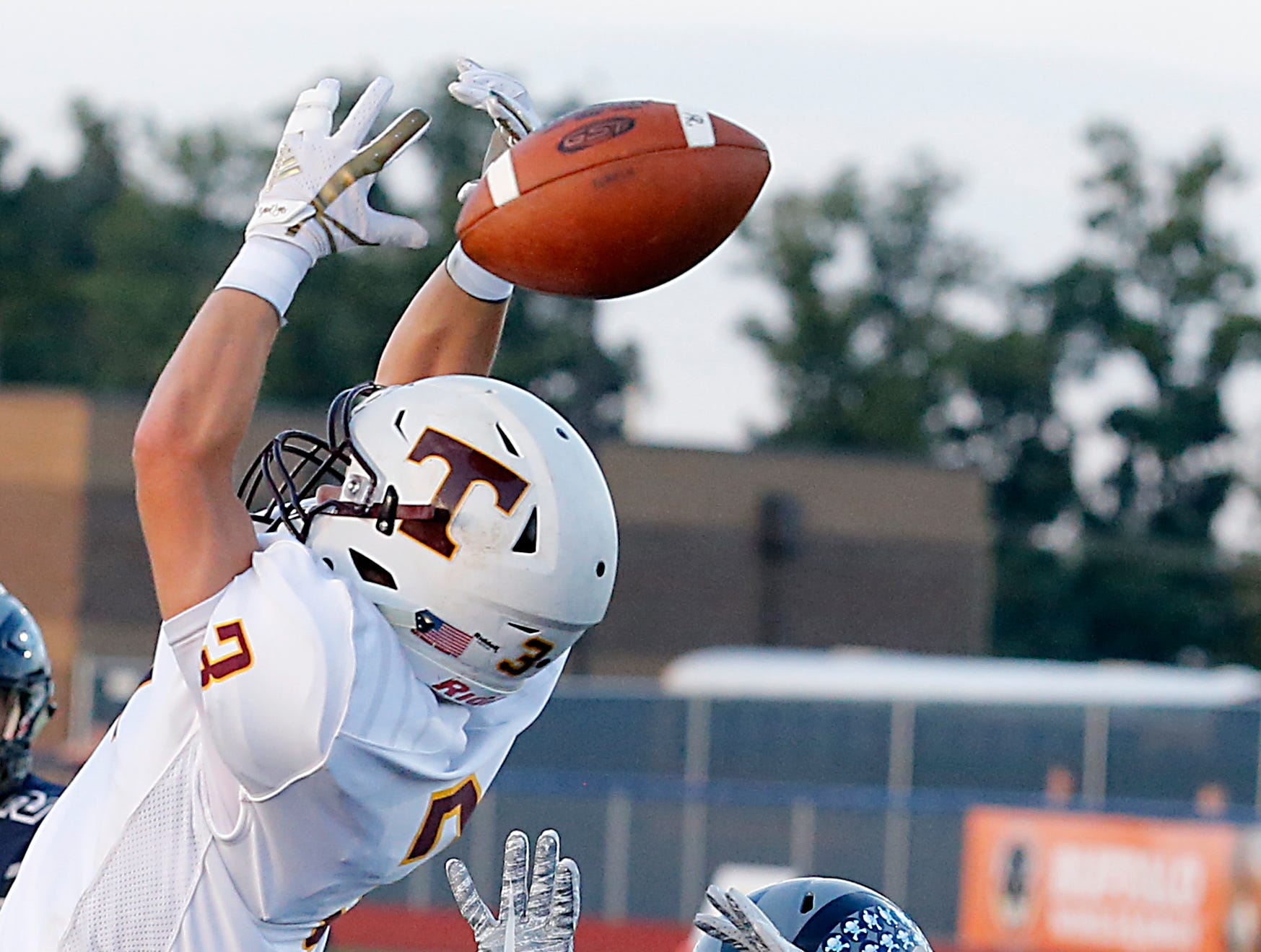 Turpin's Cody Kidd can't make the catch as West Clermont's Gage Bullock applies pressure during their 2018 Skyline Chili Crosstown Showdown at West Clermont Friday, Sept. 14, 2018.