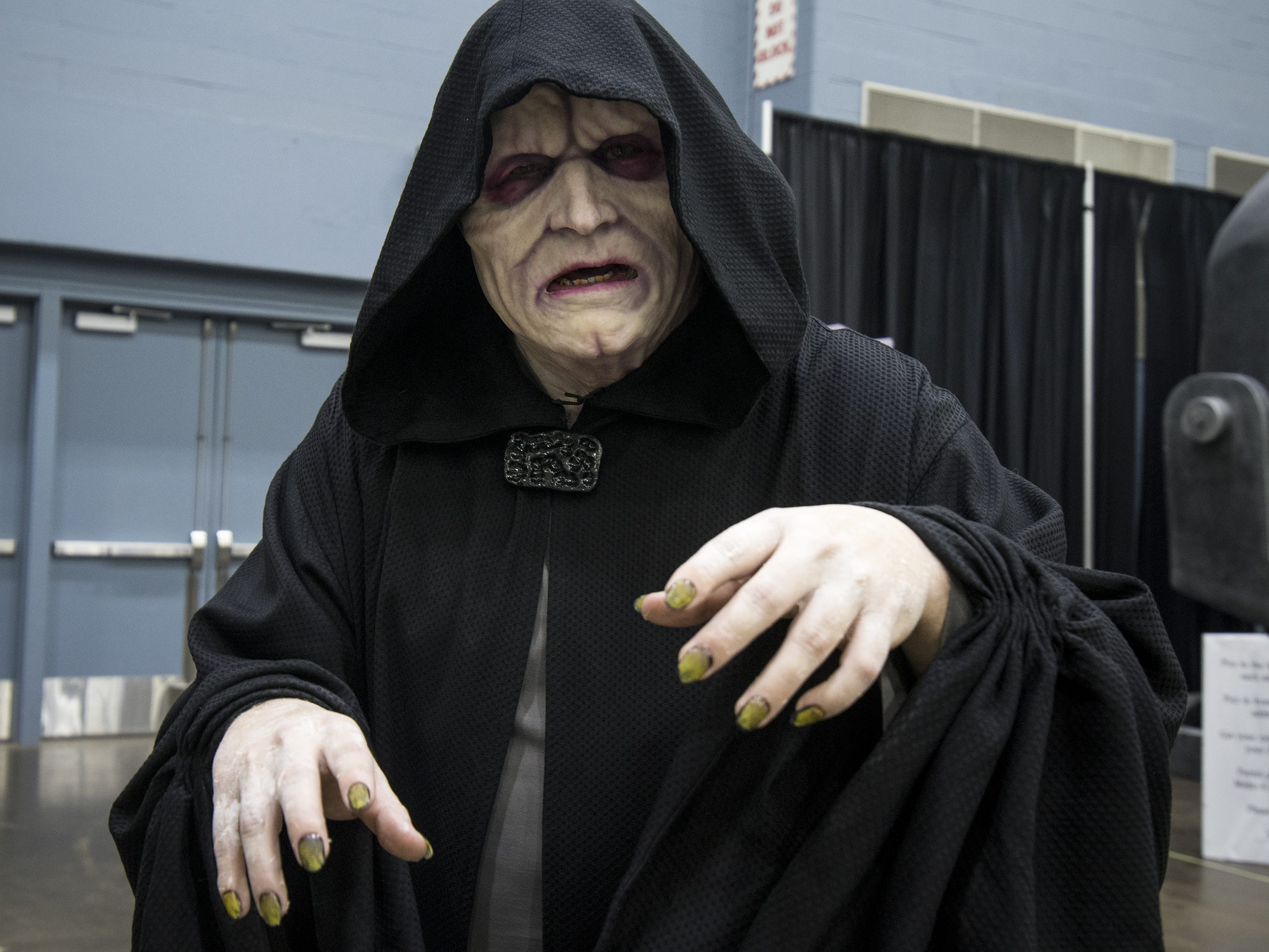 Paul Doyal of Owensboro cosplays the Emperor from Star Wars.