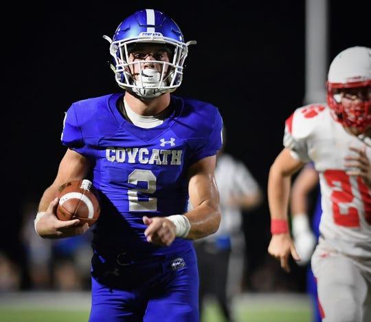 Covington Catholic's Casey McGinness scores a third-quarter touchdown against Beechwood Friday, Sept. 14, 2018.