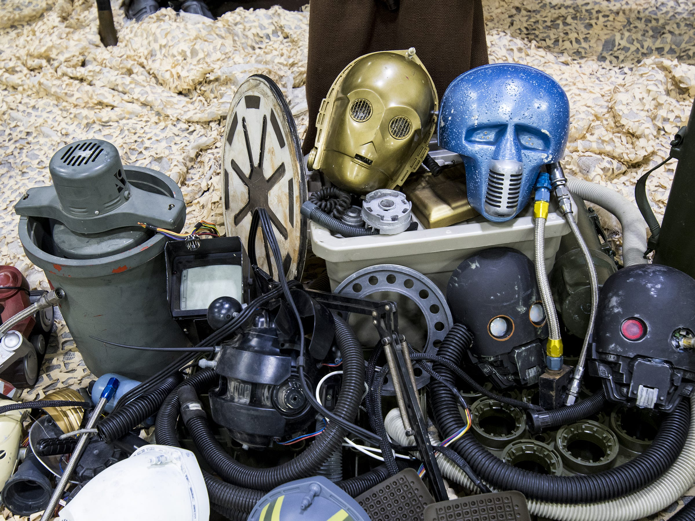 A jumble of Stars Wars props sit in a display.