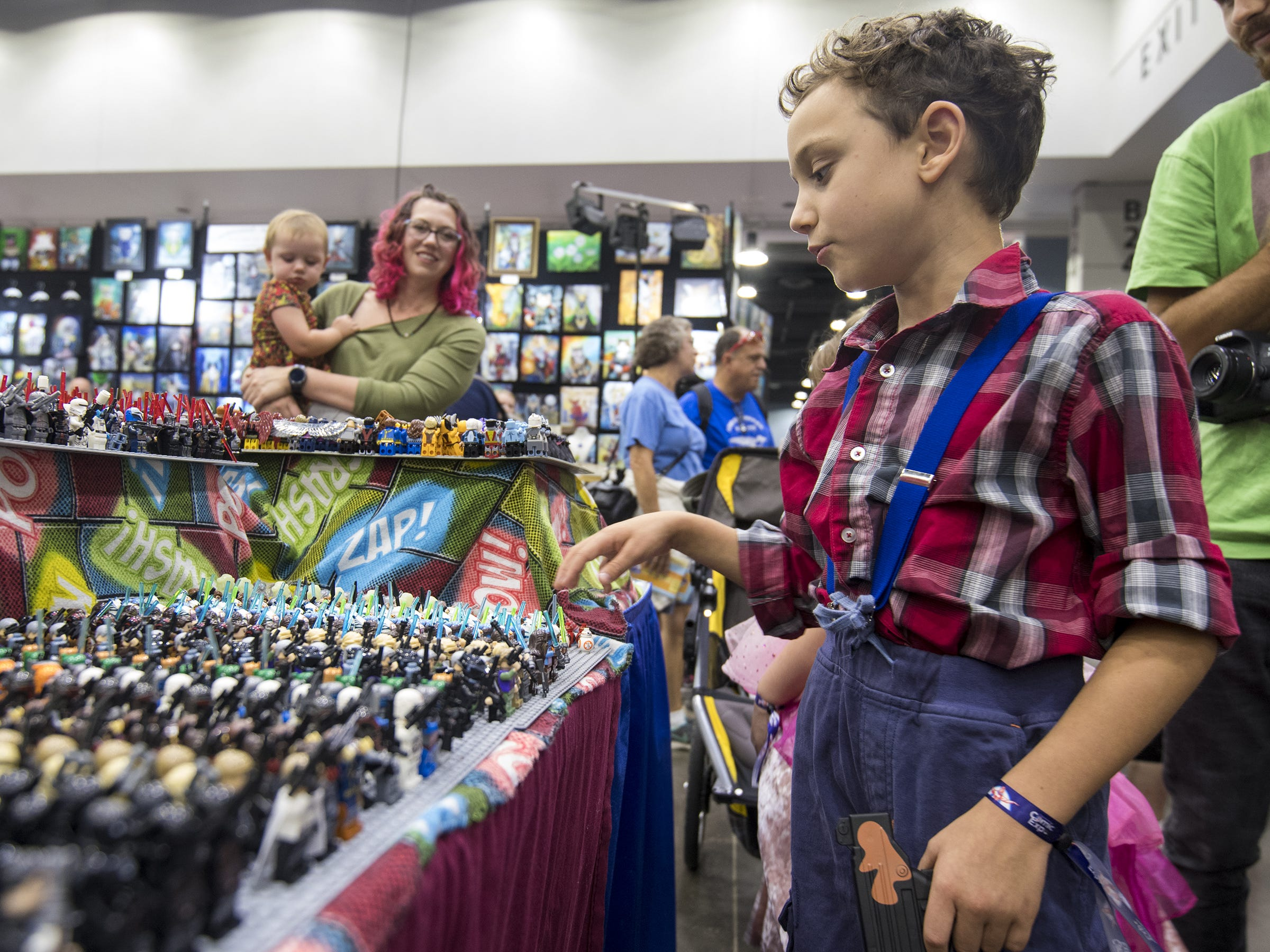 Jack Dudas, 8, of Pleasant Ridge checks out the Lego figures at the Collectible Empire booth.