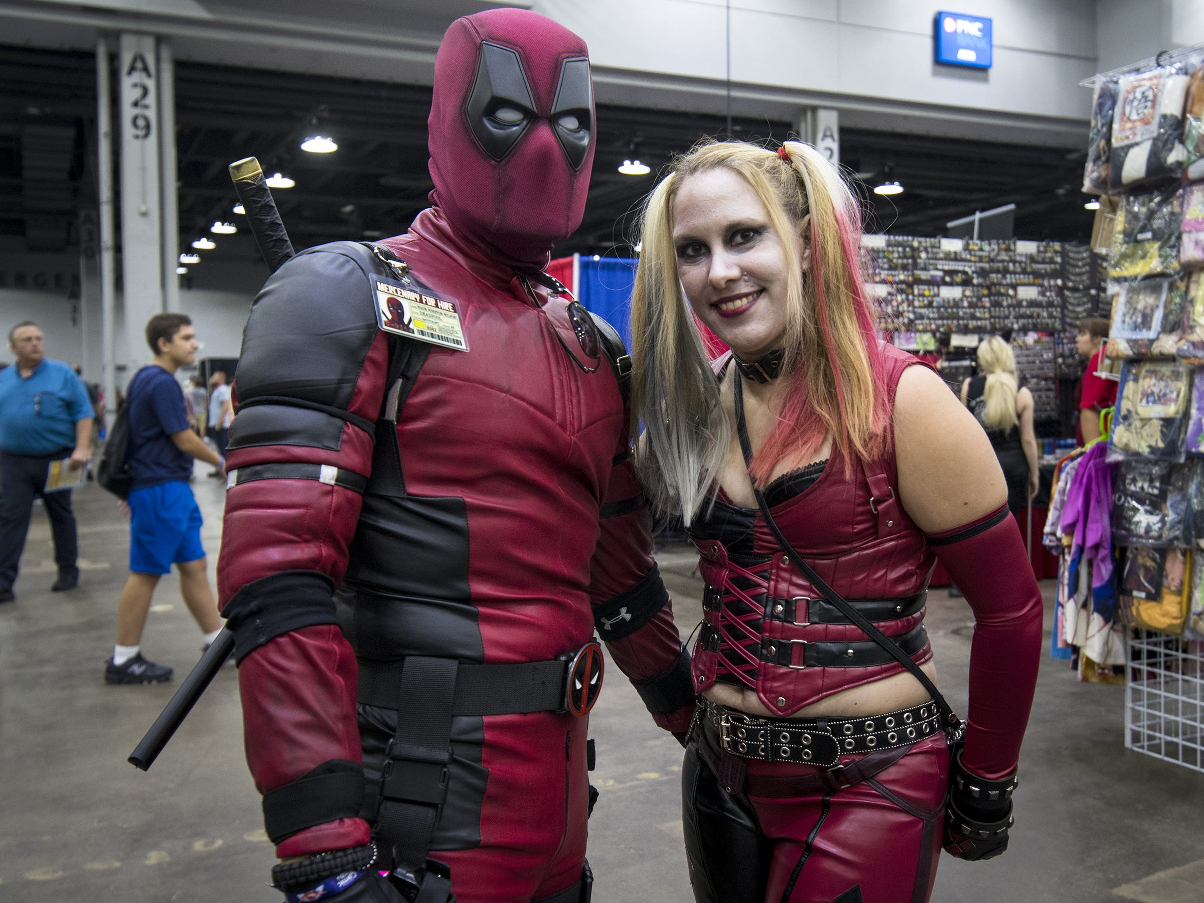 Tim Snyder and No'l Burton dress as Deadpool and Harley Quinn for the Cincinnati Comic Expo at the Duke Energy Center on Friday, Sept. 14, 2018 in Cincinnati, Ohio. The expo will run through Sunday, Sept. 16.