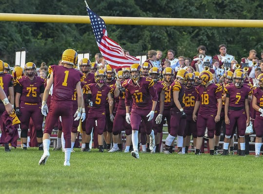 Ross players get ready to run onto the field against the Wildcats, Ross High School, Friday, September 14, 2018