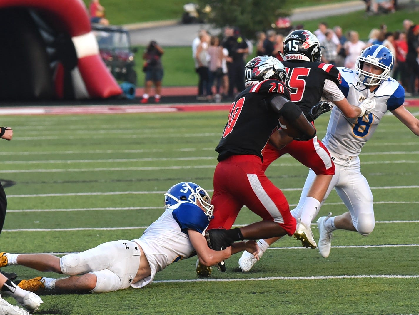 Ryan Hamm (3) of Madeira makes a shoestring tackle of John Mark Williams of Indian Hill saving a long gainer, Sept. 14, 2018.