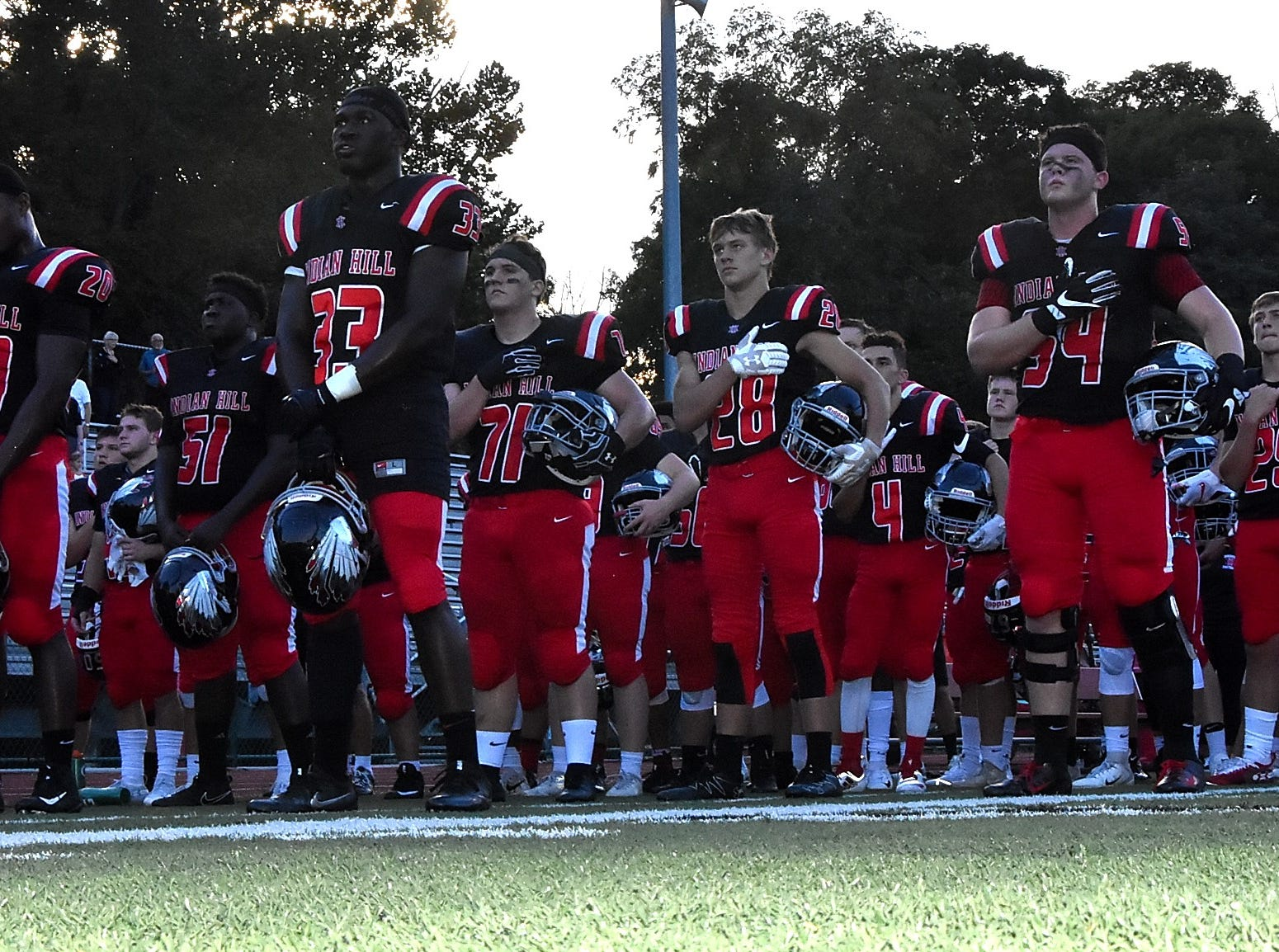 The Indian Hill Braves Football team stands in honor of America during The National Anthem, Sept. 14, 2018.