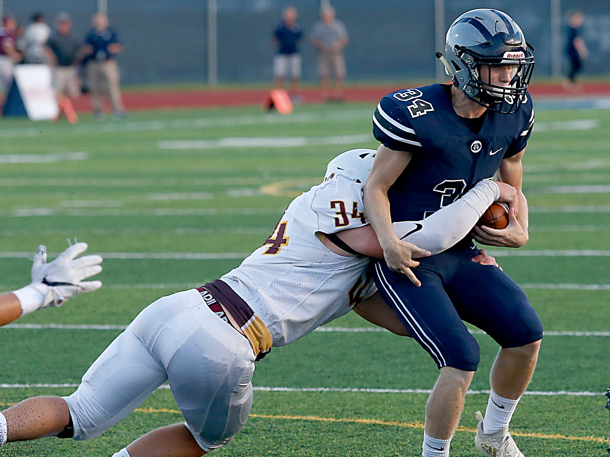 Turpin's Hunter Pembleton brings down West Clermont's Ryan Cann during their 2018 Skyline Chili Crosstown Showdown at West Clermont Friday, Sept. 14, 2018.