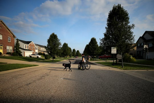 Hamilton County Commissioner Todd Portune walks his daughter's dog, Rebel, before getting ready for work, Friday, Aug. 31, 2018, in his neighborhood in Green Township, Ohio. His plan is the same every day: Start with getting up and go from there.