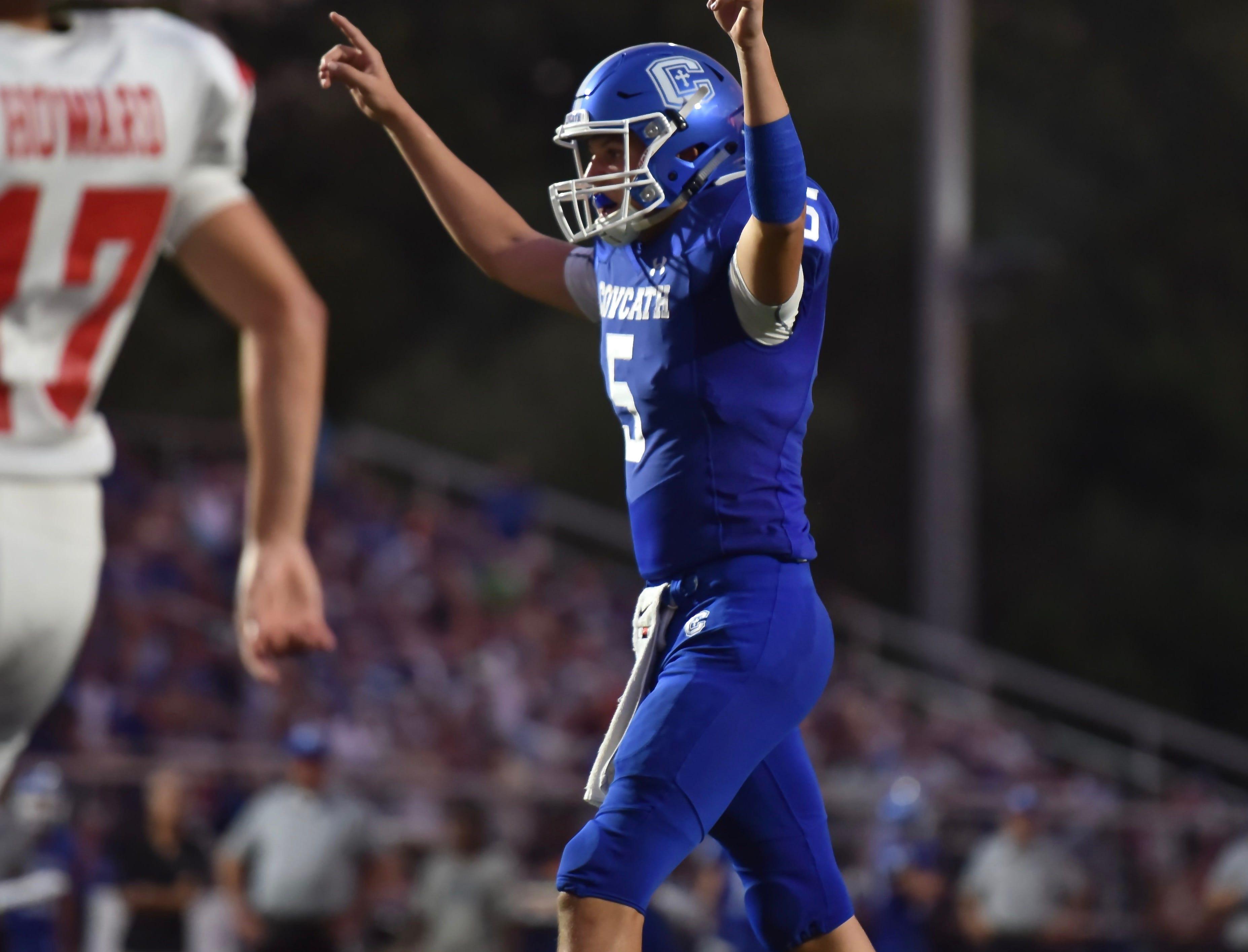 Covington Catholic's Caleb Jacob celebrates a touchdown against Beechwood Friday, Sept. 14, 2018.
