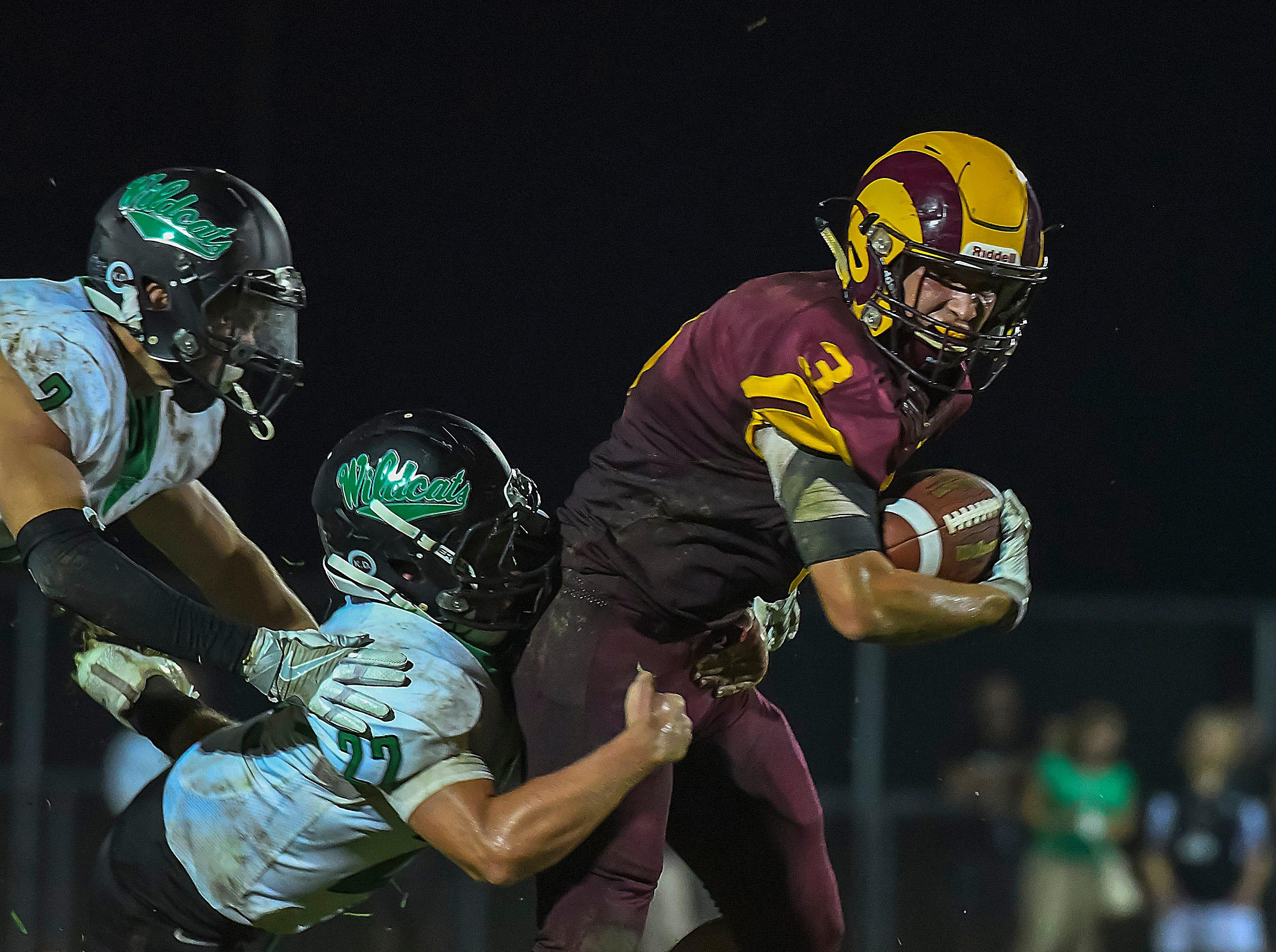 Rams running back Ethan Hall runs the ball against Harrison, Ross High School, Friday, September 14, 2018
