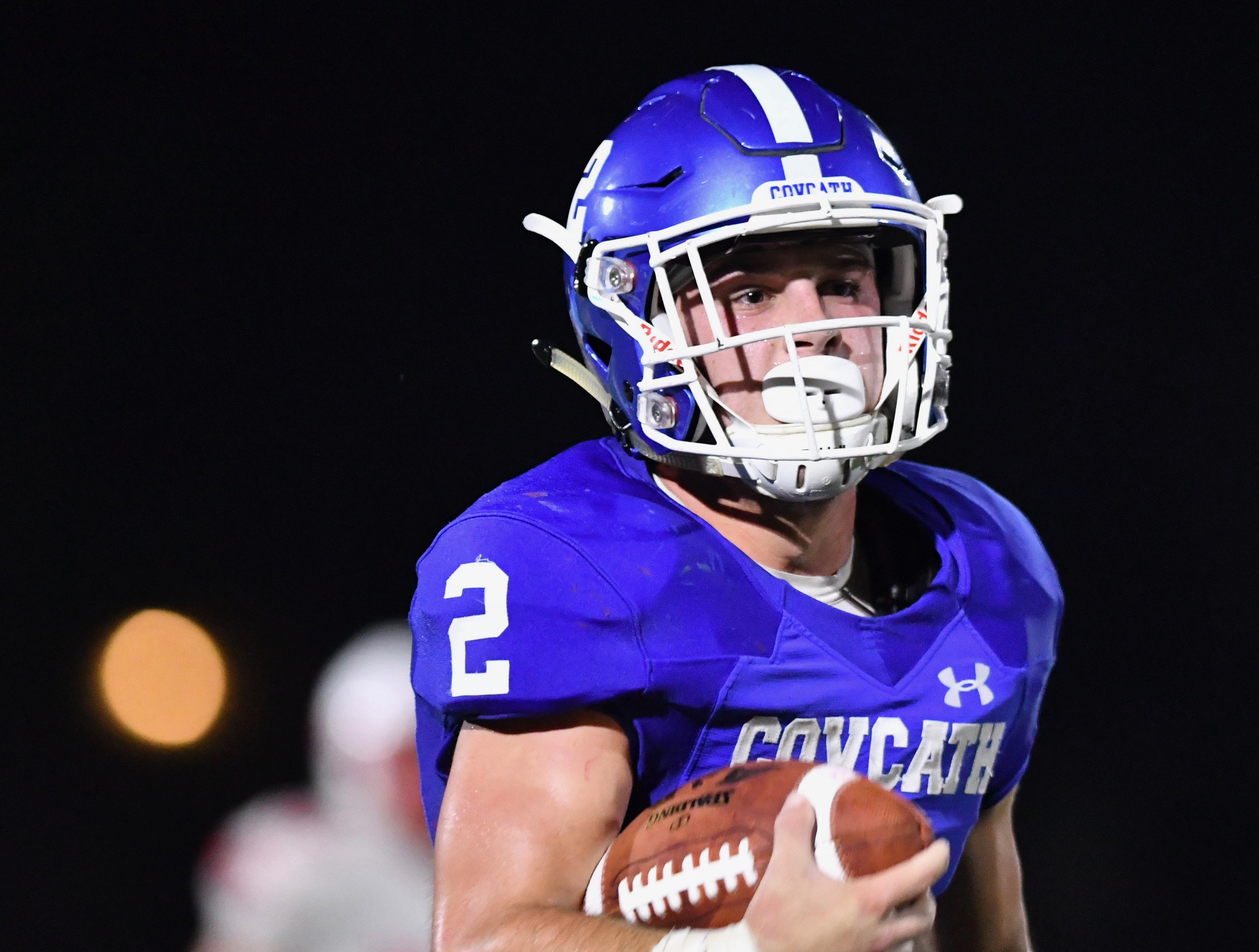 Covington Catholic's Casey McGinness scores a third-quarter touchdown against Beechwood Friday, Sept. 14, 2018.