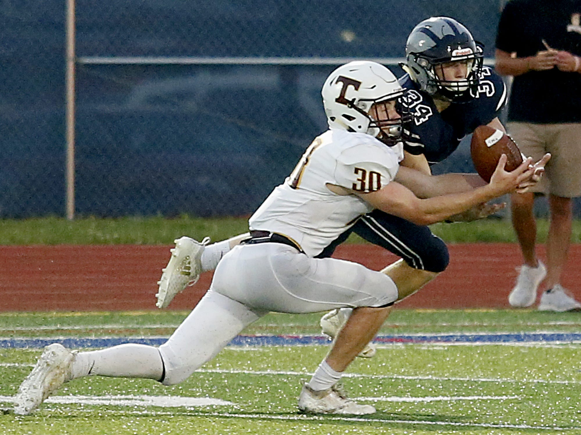 Turpin's Kaidan Naughton intercepts a pass meant from West Clermont's Ryan Cann during their 2018 Skyline Chili Crosstown Showdown at West Clermont Friday, Sept. 14, 2018.