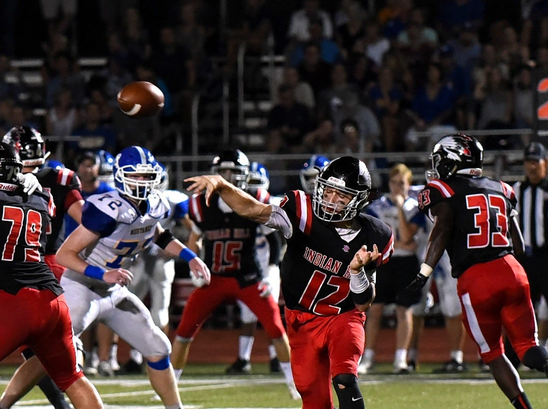 Indian Hill quarterback Cole Dein completes an outlet pass for the Braves in their win over archrival Madeira, Sept. 14, 2018.