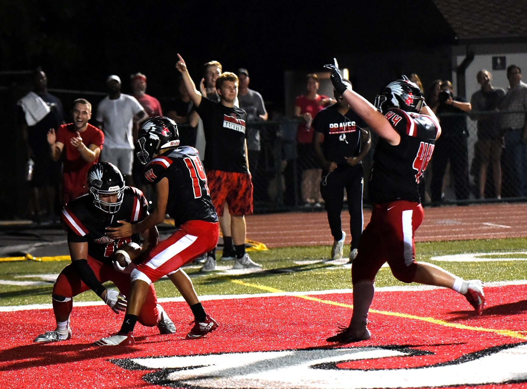 It's a Braves touchdown celebration as Indian Hill tops Madeira 30-7, Sept. 14, 2018.