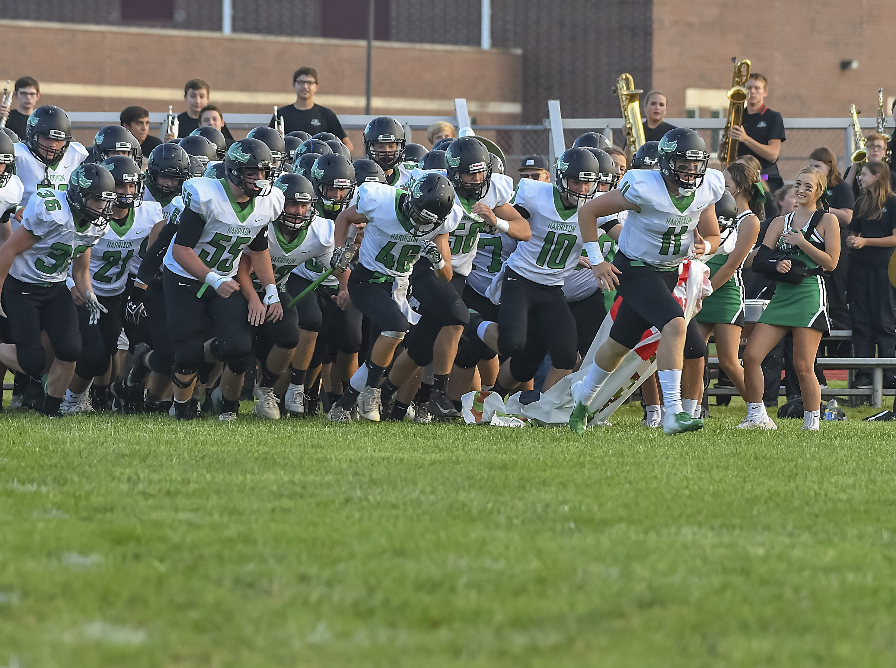 The Wildcats run on the field for their game against the Rams, Ross High School, Friday, September 14, 2018