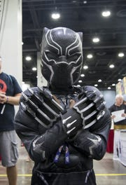 Leeona Houston, 8, dresses as the Black Panther.