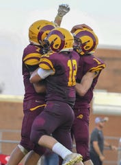 Ross players celebrate after a touchdown against Harrison, Ross High School, Friday, September 14, 2018