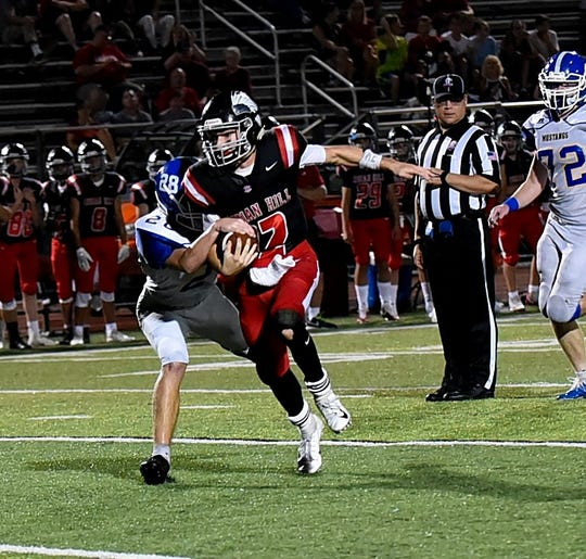 Indian Hill's Cole Dein (12) breaks free for the Braves and heads deep into Madeira territory, Sept. 14, 2018.