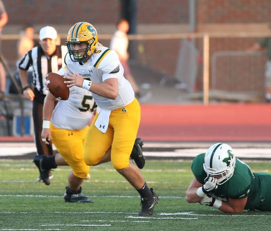 Sycamore quarterback Drew Altemuehle runs the ball during the Aviators' football game against Mason Sycamore, Friday, Sept. 14, 2018.