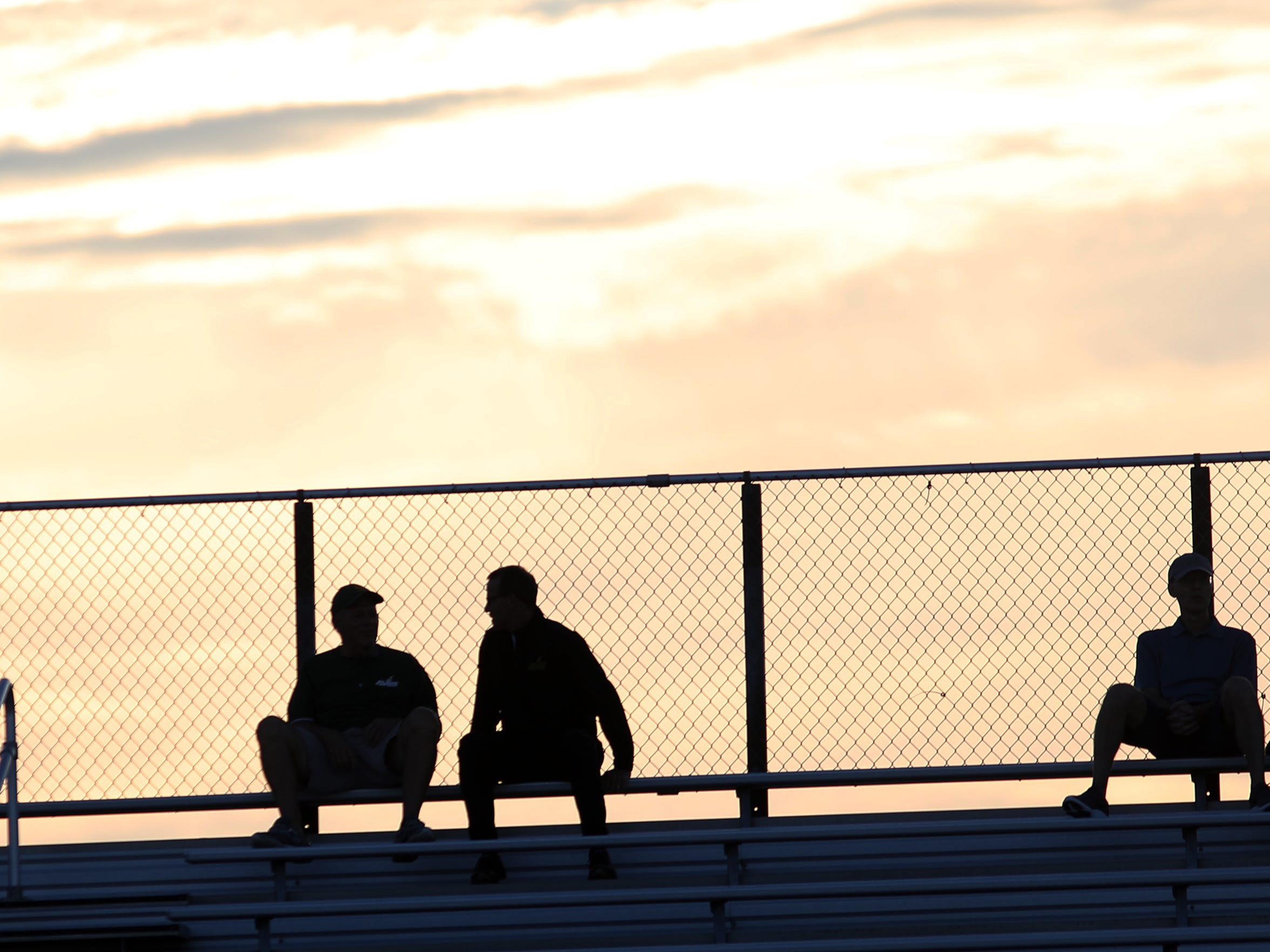 Sycamore fans sit at the top of the stadium as the sun sets before the Aviators' game against Mason, Friday, Sept. 14, 2018.
