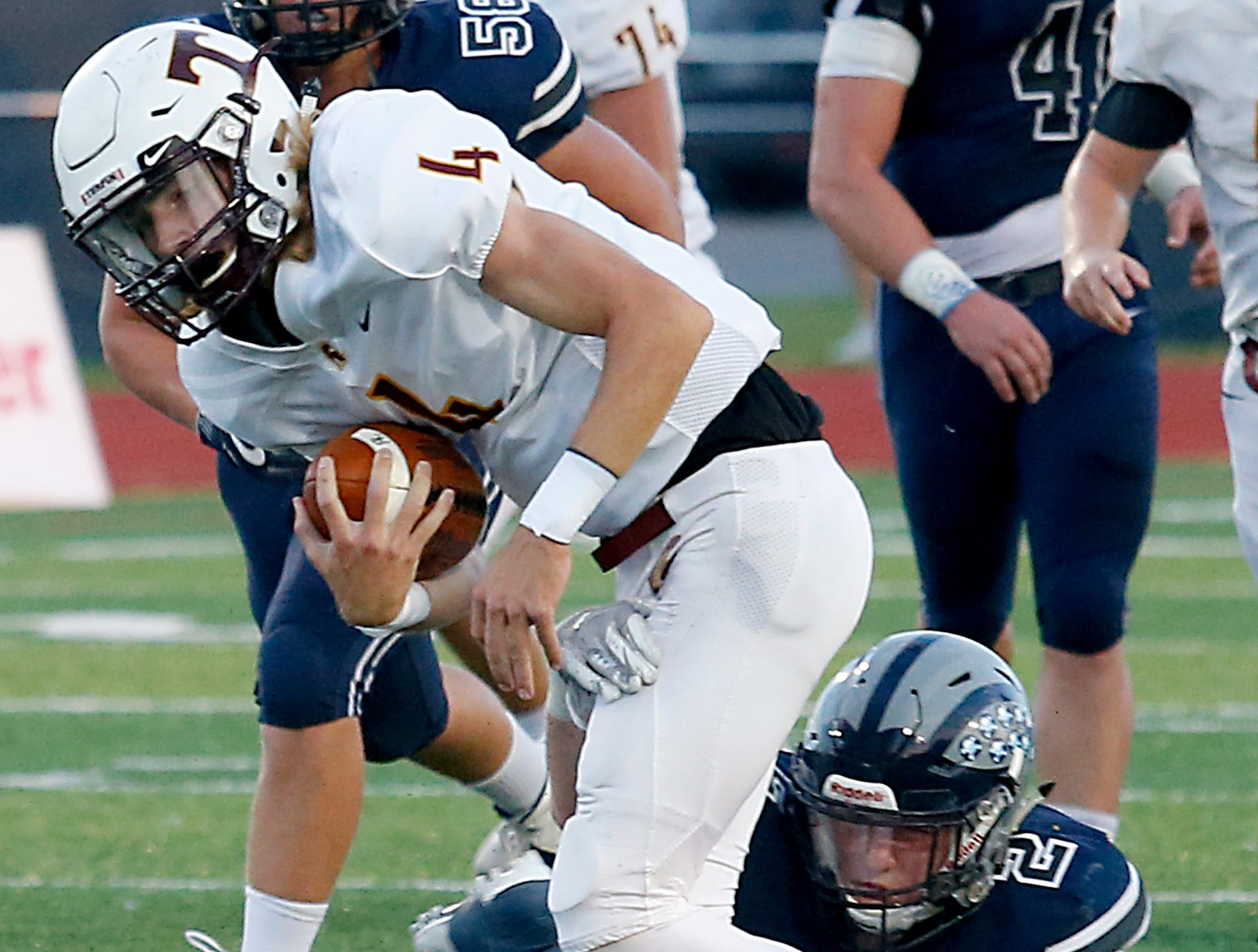 Turpin quarterback Justin Silverstein is brought down by West Clermont's Matt Lewis during their 2018 Skyline Chili Crosstown Showdown at West Clermont Friday, Sept. 14, 2018.
