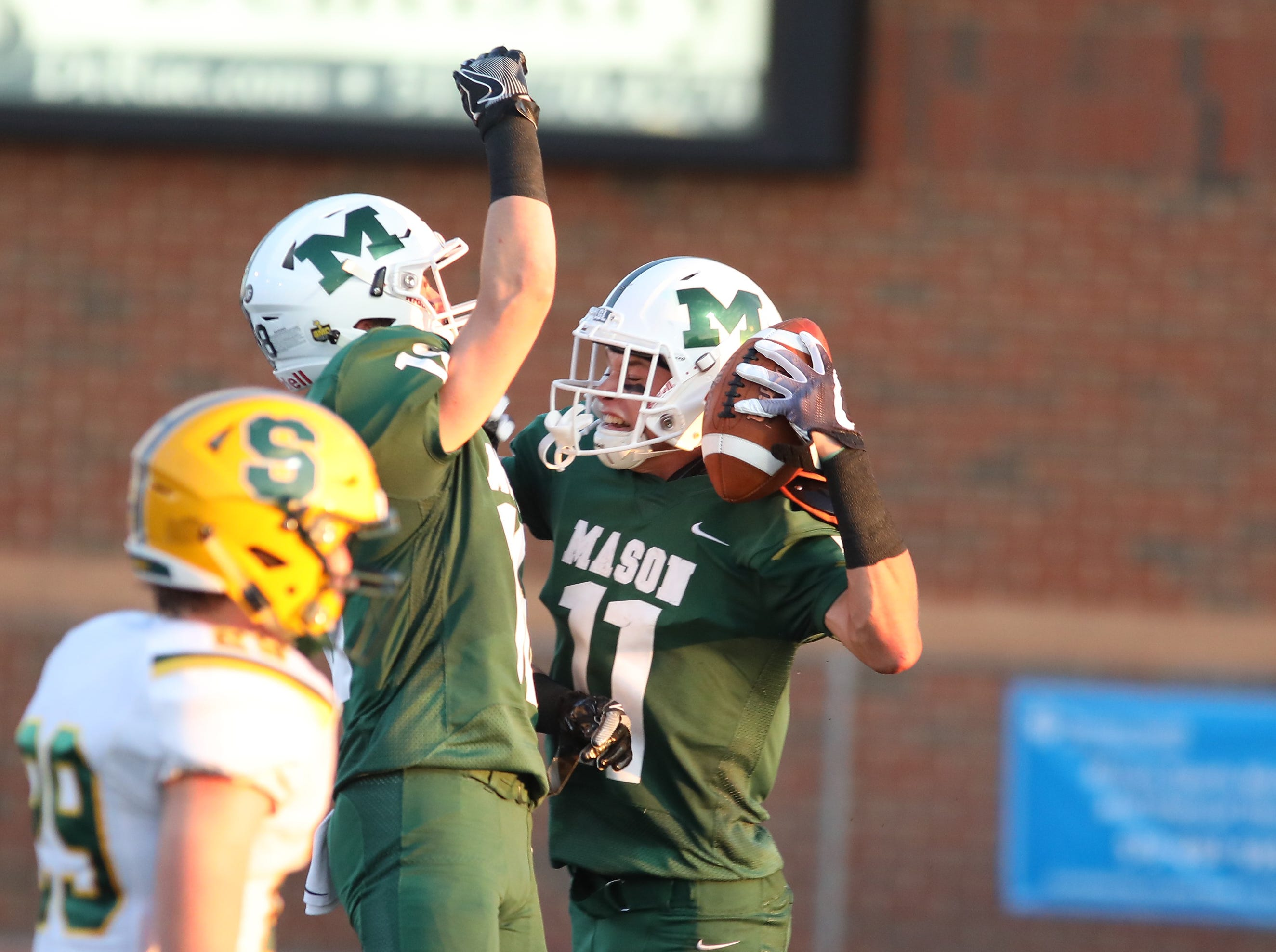 Mason's Nick Niehoff celebrates after scoring a touchdown during the football game against Sycamore, Friday, Sept. 14, 2018.