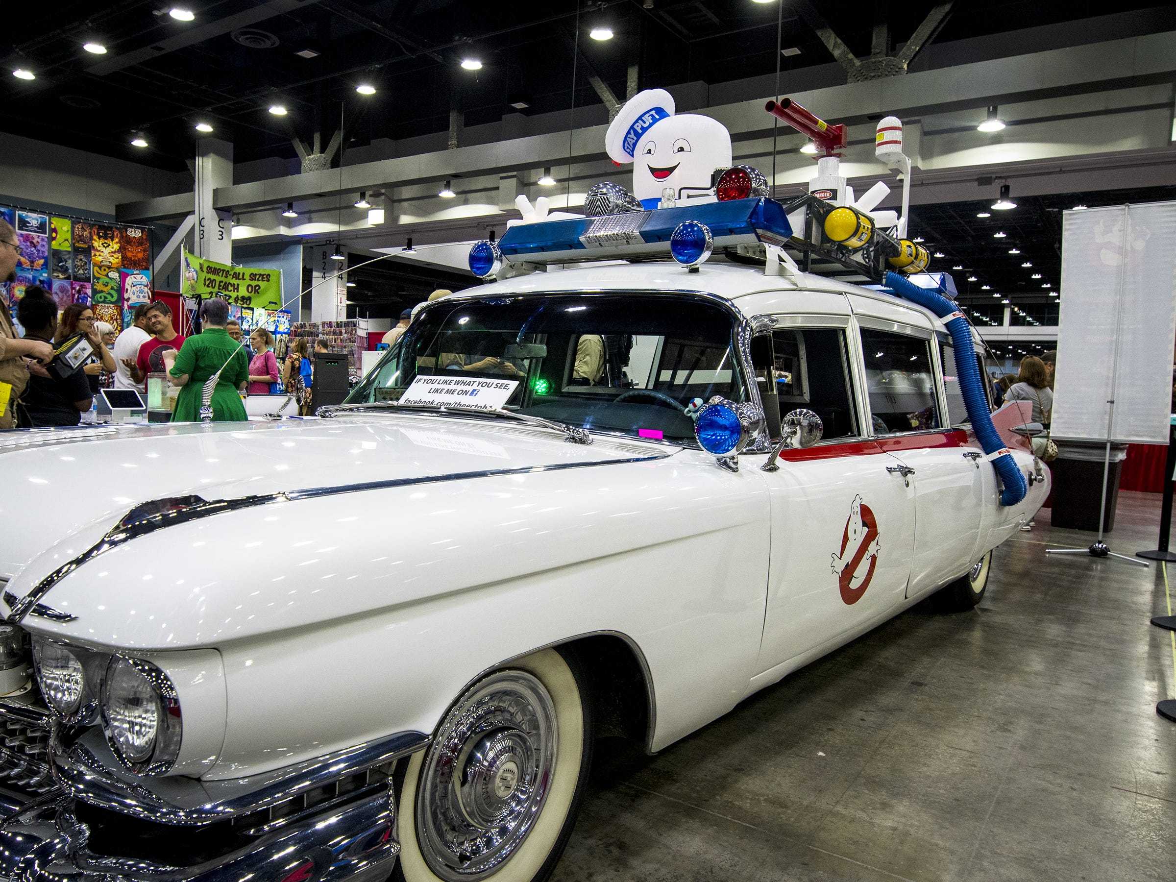 A Ghost Busters replica car is one of many props that guests can pose in front of during the Cincinnati Comic Expo at the Duke Energy Center.