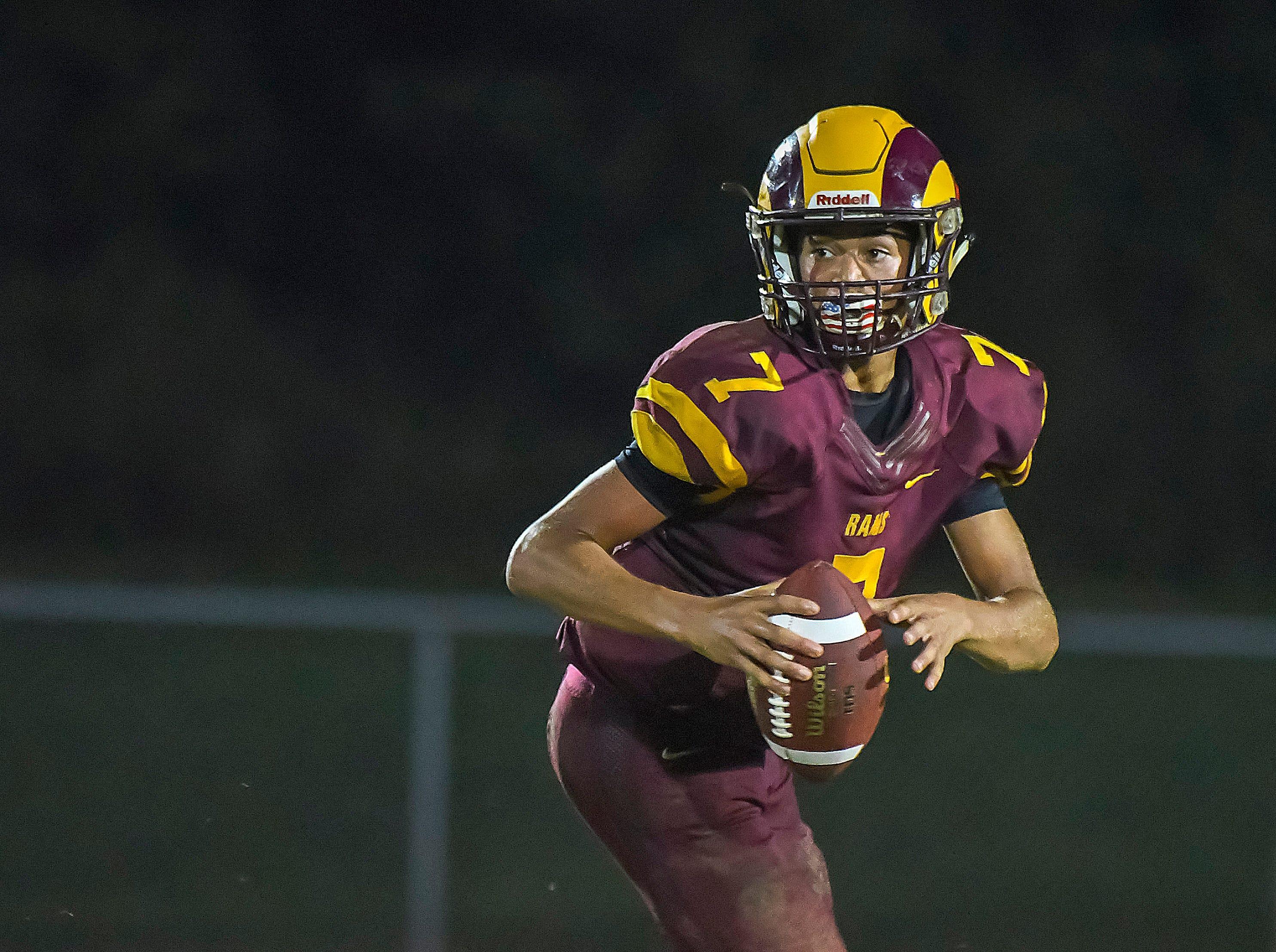 Ross quarterback C.J. Boze looks down field for a receiver against Harrison, Ross High School, Friday, September 14, 2018