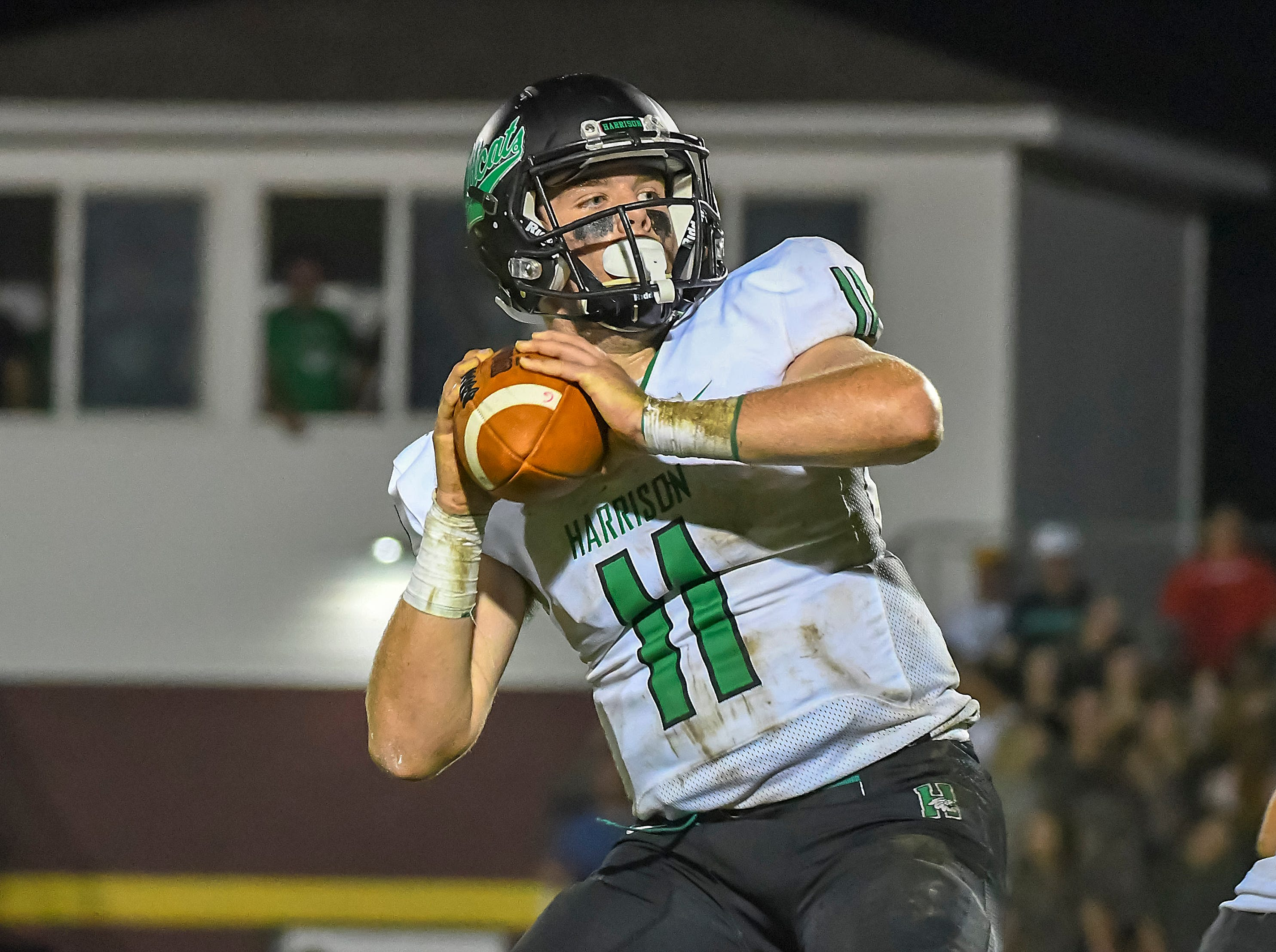 Connor Kinnett of Harrison attempts a pass against Ross, Ross High School, Friday, September 14, 2018