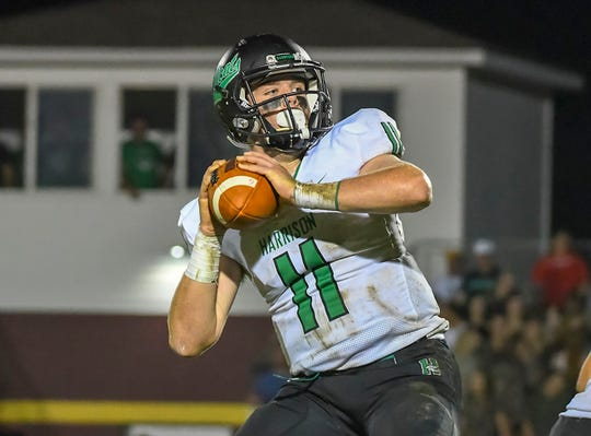 Connor Kinnett of Harrison attempts a pass against Ross, Ross High School, Friday, September 14, 2018