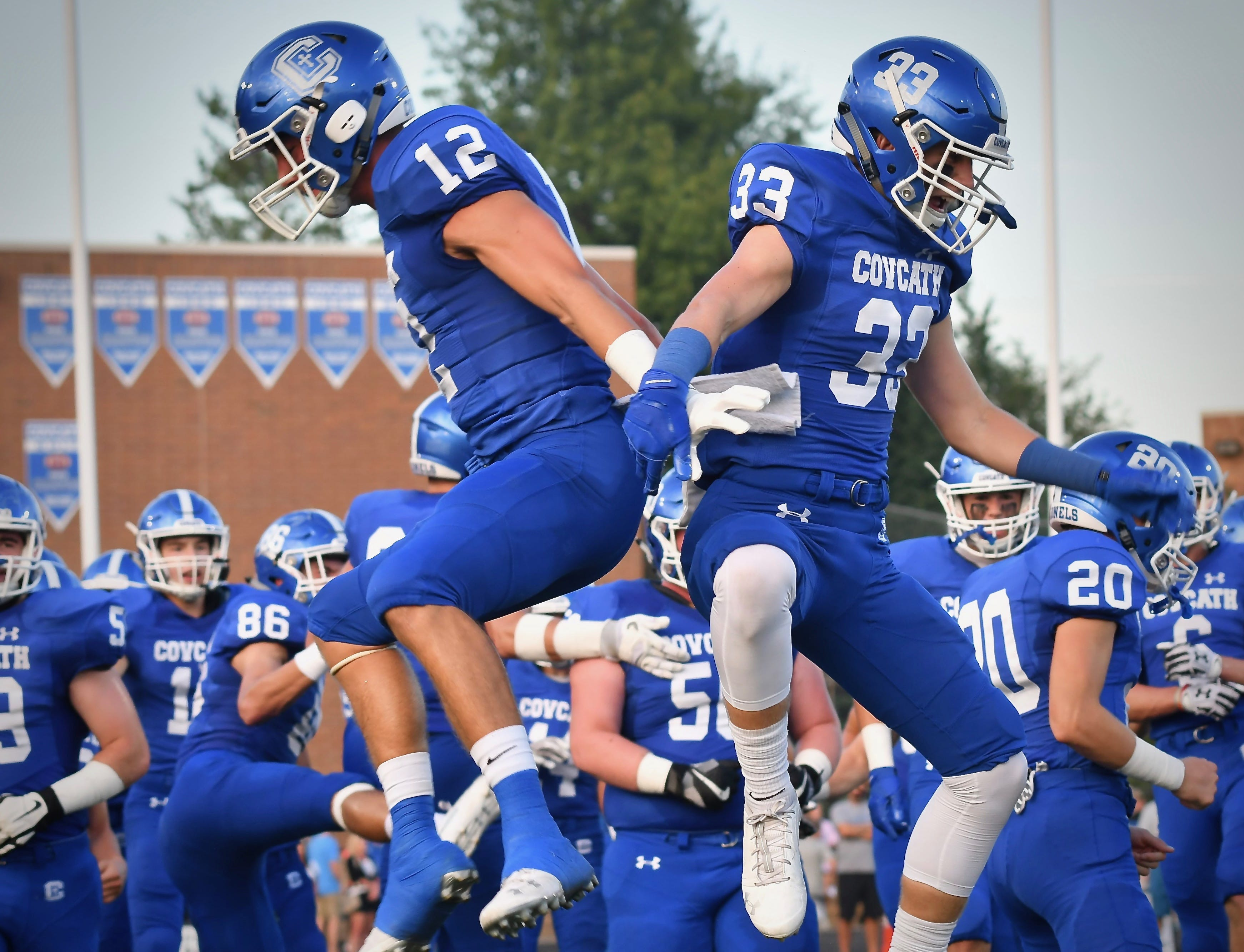 The Covington Catholic Colonels take the field Friday, Sept. 14, 2018.