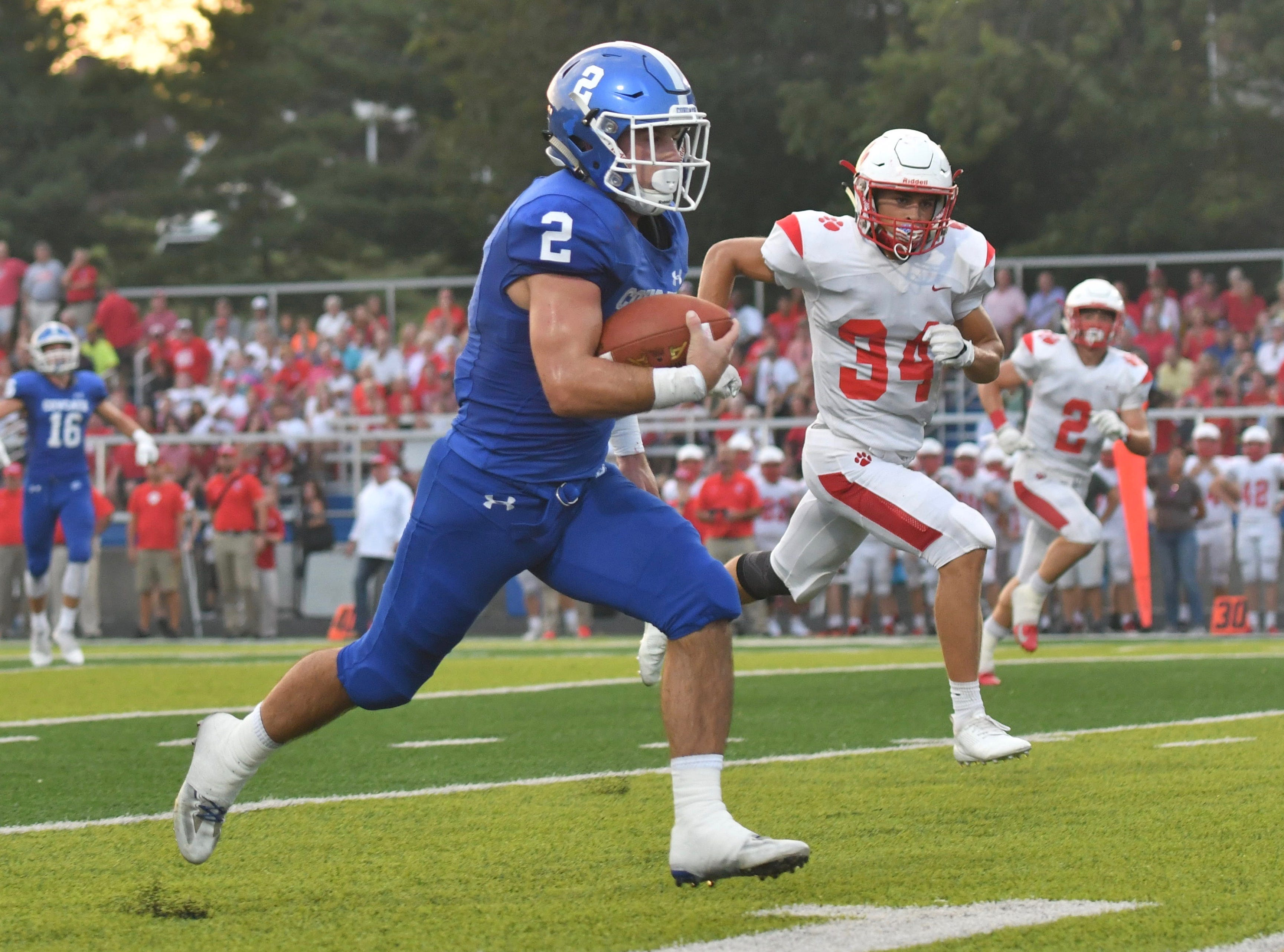 Covington Catholic's Casey McGinness breaks off a long run for a first half touchdown against Beechwood  Friday, Sept. 14, 2018.