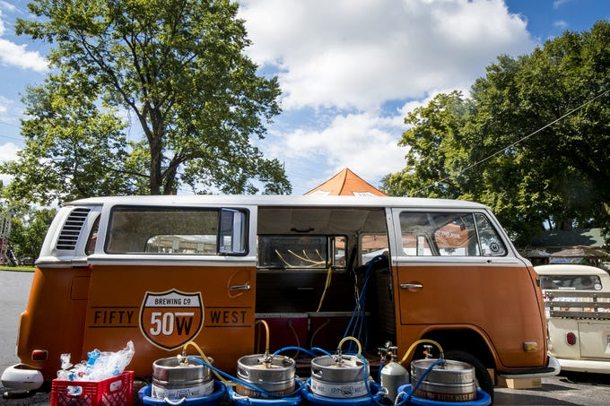 Kegs are lined up behind the iconic 50 West van during Fifty Fest Saturday, September 15, 2018 in Cincinnati, Ohio. The festival features beers from tons of local breweries.