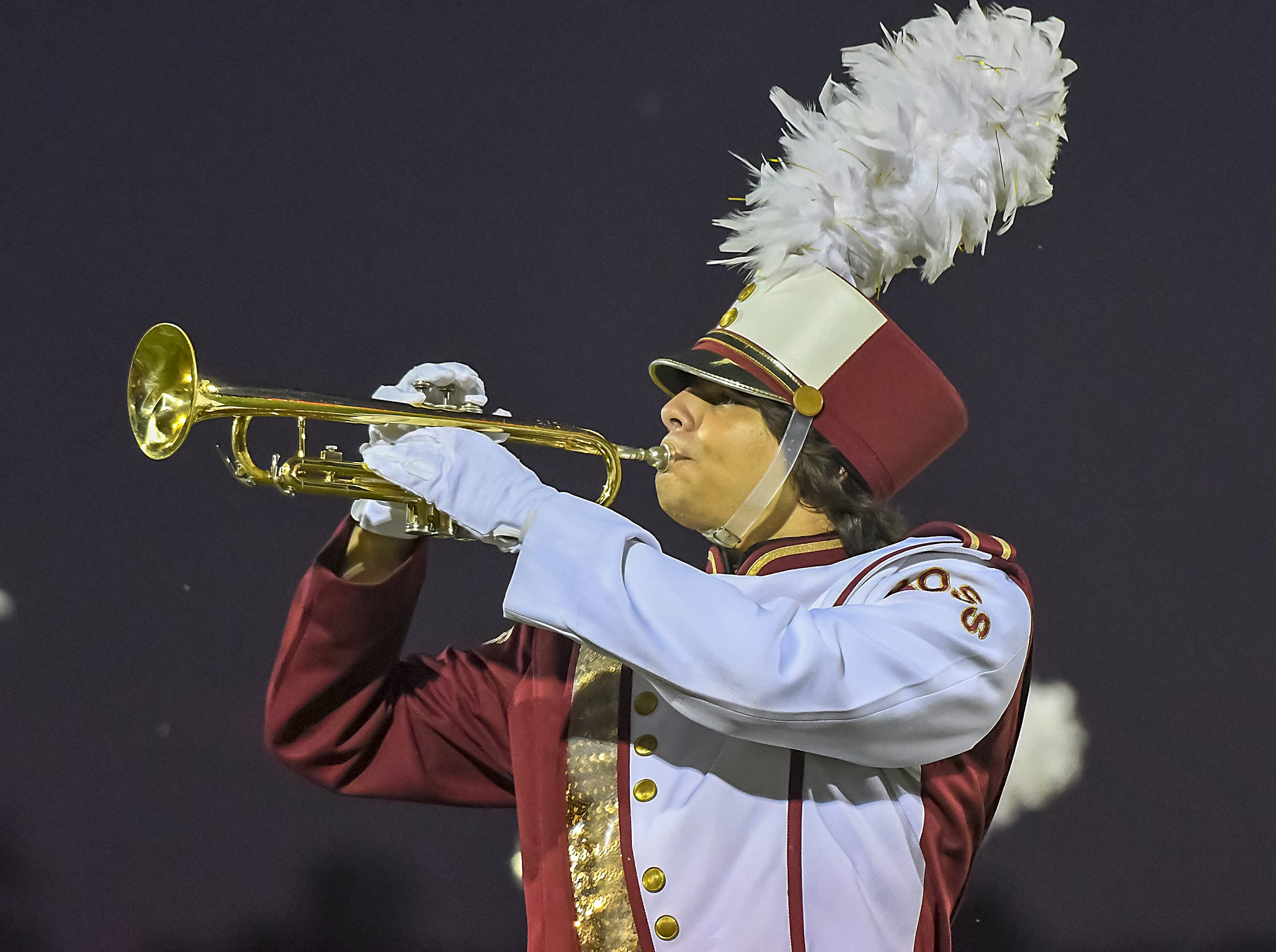 A Ross band member plays his trumpet during halftime of the  Home Coming game against Harrison, Ross High School, Friday, September 14, 2018