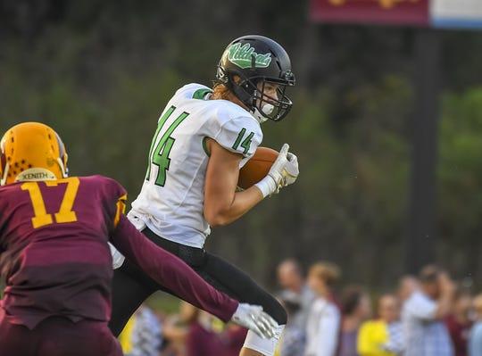 Jace Fette of Harrison catches a pass against Ross, Ross High School, Friday, September 14, 2018