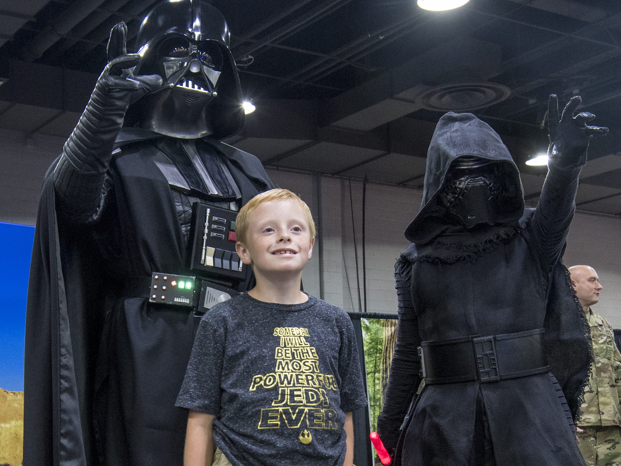 Lucas Hoffman of Lawrenceburg gets a photo with Darth Vader and Kylo Ren from Star Wars.