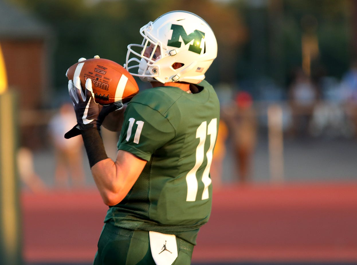 Mason's Nick Niehoff catches a touchdown pass for the Comets during the football game against Sycamore, Friday, Sept. 14, 2018.